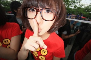"""Asian girl """"shhh""""."""